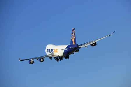 taking off: Amsterdam, the Netherlands  - August, 18th 2016: N496MC Atlas Air Boeing 747-47UF,  taking off from Polderbaan Runway Amsterdam Airport Schiphol