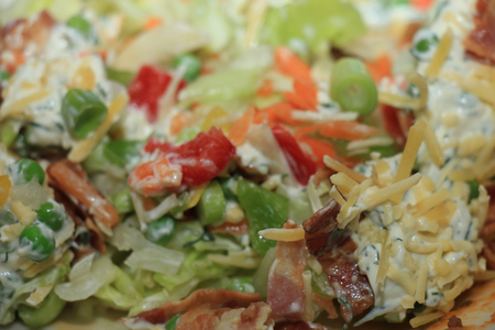 Fresh salad, appetizer with crudités, bacon and cream cheese Imagens