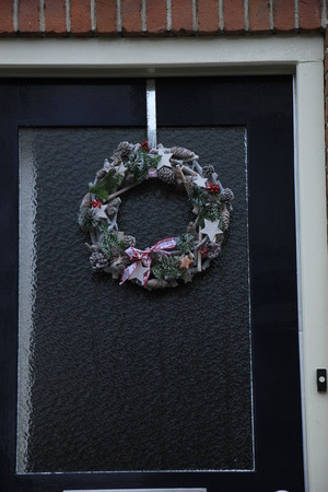 Classic Christmas Wreath With Decorations On A Glass Door Stock