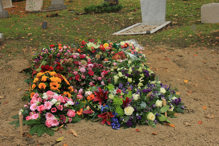 sympathy flowers: Fresh flowers on a grave after a funeral