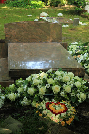 sympathy flowers: Various sympathy or funeral flowers on a grave