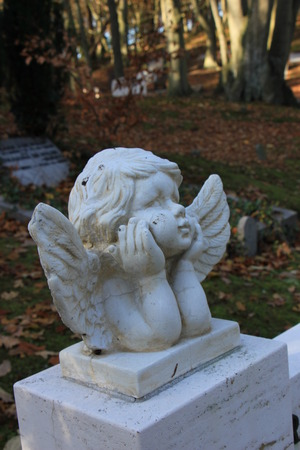 angel cemetery: a Guardian angel grave ornament on a cemetery