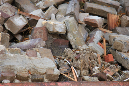 Bricks in a dumpster near a construction site, home renovation Banco de Imagens