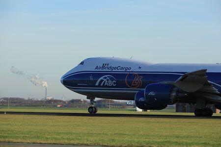 boeing 747: Amsterdam, the Netherlands  - November 25th, 2016:  VQ-BVR AirBridgeCargo Boeing 747 taking off from Polderbaan Runway at Amsterdam Airport Schiphol Editoriali