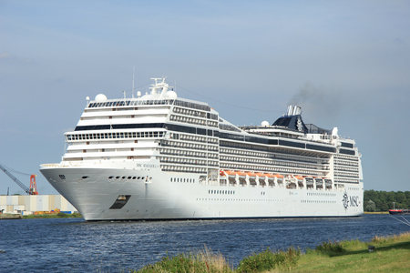 Velsen, the Netherlands, July 7th, 2014 : MSC Magnifica on North Sea Canal from Amsterdam towards the Ijmuiden locks, The Magnifica is operated by MSC since 2010 and  293.8 metres (964 ft) long.