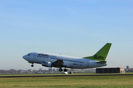 Amsterdam, the Netherlands  - November 25th, 2016: YL-BBM Air Baltic Boeing 737 taking off from Polderbaan Runway at Amsterdam Airport Schiphol