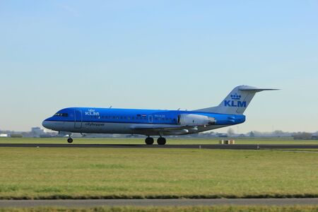 Amsterdam, the Netherlands  - November 25th, 2016: PH-KZE KLM Cityhopper Fokker F70 taking off from Polderbaan Runway at Amsterdam Airport Schiphol