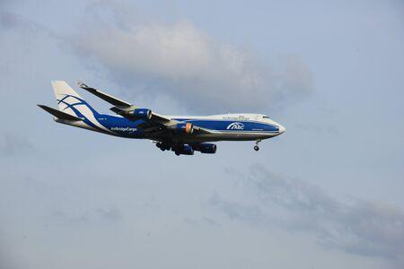 boeing 747: Amsterdam Schiphol Airport - April 1st 2016: VQ-BHE AirBridgeCargo Boeing 747 approaching Polderbaan runway