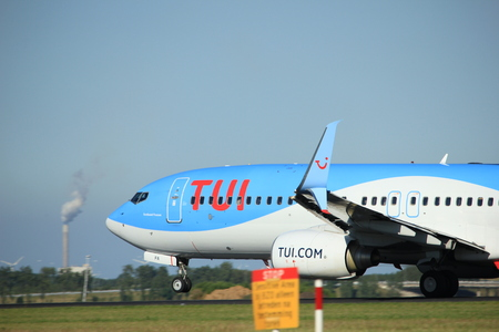 Amsterdam, the Netherlands  - August, 18th 2016: PH-TFA  TUI Airlines Netherlands Boeing 737-86N  taking off from Polderbaan Runway Amsterdam Airport Schiphol Editorial