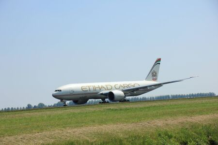 Amsterdam, The Netherlands - June 12 2015: A6-DDB Etihad Airways Boeing 777-FFX takes off at Amsterdam Airport Schiphol Polderbaan runway. Etihad Airways is the flag carrier of Abu Dhabi and the second-largest airline of the United Arab Emirates,
