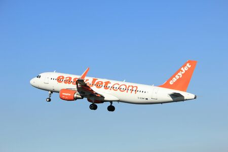 Amsterdam, the Netherlands  - August, 18th 2016: G-EZWT easyJet Airbus A320-214  taking off from Polderbaan Runway Amsterdam Airport Schiphol