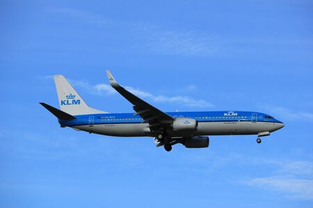 Amsterdam, the Netherlands - July 15th 2016: PH-BCE KLM Royal Dutch Airlines Boeing 737 approaching Polderbaan runway at Schiphol Amsterdam Airport, arriving from Lisbon, Portugal Editorial