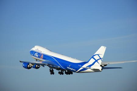 boeing 747: Amsterdam, the Netherlands - June 9th 2016:  VQ-BFE AirBridgeCargo Boeing 747-83QF , take off from Polderbaan runway Schiphol, destination Milan, Italy
