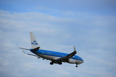 Amsterdam, the Netherlands - July 15th 2016:PH-BGW KLM Royal Dutch Airlines Boeing 737 approaching Polderbaan runway at Schiphol Amsterdam Airport, arriving from Birmingham, United Kingdom Editorial