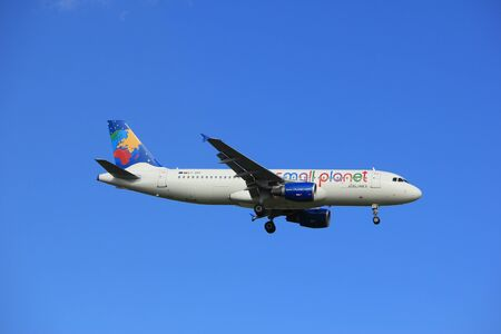 polderbaan: Amsterdam, the Netherlands - July 15th 2016: LY-SPF Small Planet Airlines Airbus A320-214, approaching Polderbaan runway at Schiphol Amsterdam Airport, arriving from Las Palmas, Spain