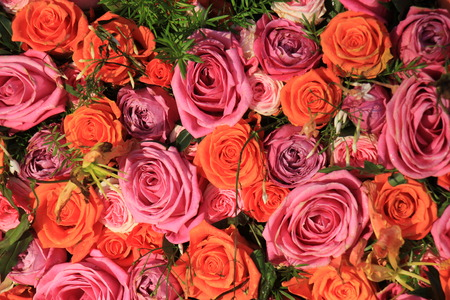 mixed marriage: Mixed pink and orange roses in a floral wedding decoration Stock Photo