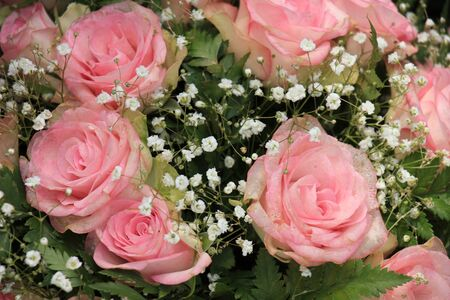 mixed marriage: A pink rose bouquet for a wedding