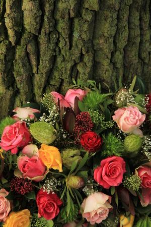 sympathy flowers: A floral sympathy wreath near a tree Stock Photo