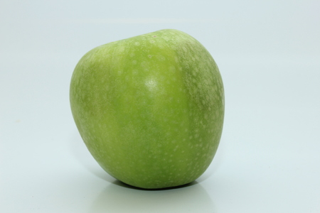 granny smith: a fresh green Granny Smith apple on a white background