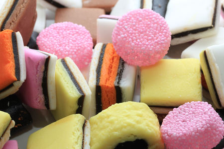 liquorice: Pile of liquorice allsorts in different shapes, colors and sizes
