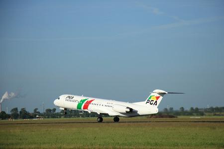 Amsterdam the Netherlands - June 9th, 2016: CS-TPF Portugália Fokker F100  takeoff fro Polderbaan runway, destination Porto, Portugal Editorial