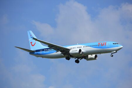 polderbaan: Amsterdam, the Netherlands - July 21st 2016: PH-BXB PH-TFB TUI Airlines Netherlands Boeing 737 Boeing 737,  approaching Polderbaan runway at Schiphol Amsterdam Airport, arriving from Eindhoven, the Netherlands