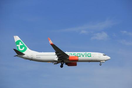 polderbaan: Amsterdam, the Netherlands - July 21st 2016: PH-GGX  Transavia Boeing 737,  approaching Polderbaan runway at Schiphol Amsterdam Airport, arriving from Barcelona, Spain