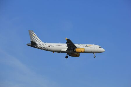 polderbaan: Amsterdam, the Netherlands - July 21st 2016:EC-LUN Vueling  Airbus A320, approaching Polderbaan runway at Schiphol Amsterdam Airport, arriving from Naples