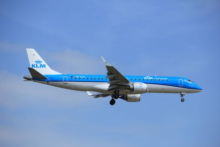 polderbaan: Amsterdam, the Netherlands - July 21st 2016: PH-EZN KLM Cityhopper Embraer ERJ-190STD, approaching Polderbaan runway at Schiphol Amsterdam Airport, arriving from Bilbao, Spain Editorial