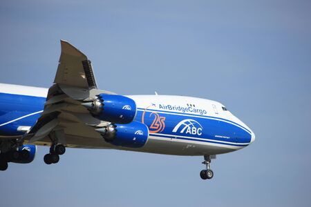 polderbaan: Amsterdam, the Netherlands - July 21st 2016:VQ-BGZ AirBridgeCargo Boeing 747, approaching Polderbaan runway at Schiphol Amsterdam Airport, arriving from Moscow, Russia