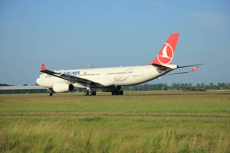 Amsterdam, the Netherlands - June 9th 2016: TC-JNL Turkish Airlines Airbus A330-343, departing from Polderbaan runway Schiphol, destination Istanbul, Turkey
