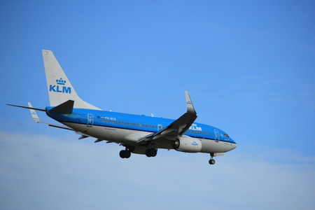 Amsterdam, the Netherlands - July 15th 2016: PH-BGX KLM Royal Dutch Airlines Boeing 737 approaching Polderbaan runway at Schiphol Amsterdam Airport, arriving from Geneva, Switzerland Editorial