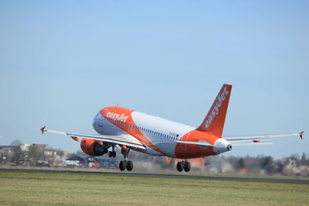 Amsterdam the Netherlands - March 25th, 2017: G-EZFS easyJet Airbus A319-100 takeoff from Polderbaan runway.