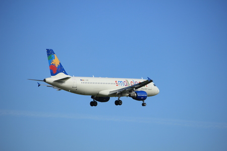 Amsterdam, the Netherlands - July 15th 2016: LY-SPF Small Planet Airlines Airbus A320-214, approaching Polderbaan runway at Schiphol Amsterdam Airport, arriving from Las Palmas, Spain