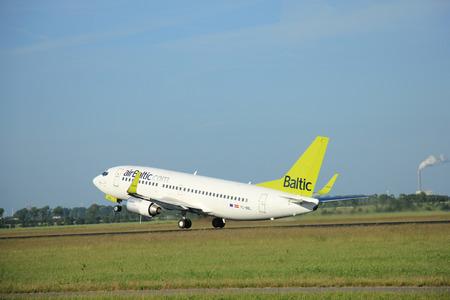 bbl: Amsterdam the Netherlands - June 9th, 2016: YL-BBL Air Baltic Boeing 737-33V(WL)   takeoff fro Polderbaan runway, destination Riga, Latvia