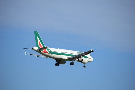 Amsterdam, the Netherlands - July 15th 2016:EI-DSB Alitalia Airbus A320, approaching Polderbaan runway at Schiphol Amsterdam Airport, arriving from Rome, Italy