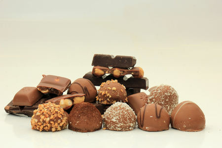 sorts: Different sorts of chocolates: bonbons and broken pieces of a chocolate bar Stock Photo