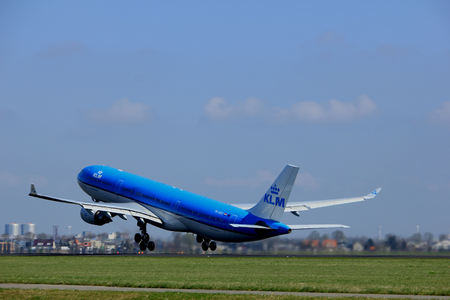 polderbaan: Amsterdam the Netherlands - April 2nd, 2017: PH-AKD KLM Royal Dutch Airlines Airbus A330-300 takeoff from Polderbaan runway, Amsterdam Airport Schiphol Editorial