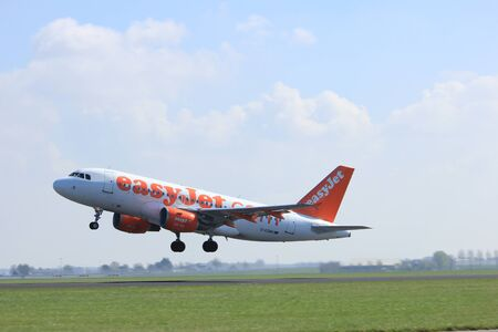 holland: Amsterdam the Netherlands - April 2nd, 2017: G-EZMH easyJet Airbus A319-100 takeoff from Polderbaan runway, Amsterdam Airport Schiphol