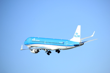 polderbaan: Amsterdam the Netherlands - April 7th, 2017: PH-EZB KLM Cityhopper Embraer ERJ-190STD takeoff from Polderbaan runway, Amsterdam Airport Schiphol