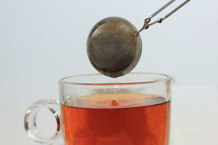 Metal tea infuser with tea dripping out