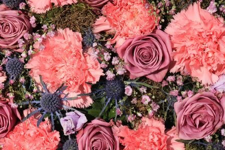 mixed marriage: Pink Carnations and roses in a floral wedding decoration