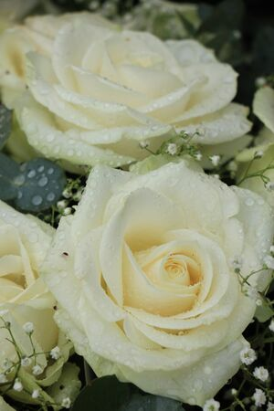 mixed marriage: White roses and babys-breath in a floral wedding decoration Stock Photo