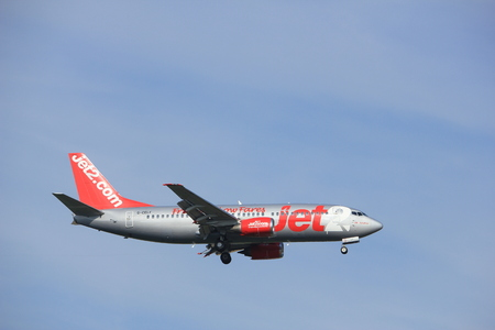 Amsterdam, the Netherlands - July 21st 2016: G-CELF Jet2 Boeing 737,  approaching Polderbaan runway at Schiphol Amsterdam Airport, arriving from Leeds Editorial