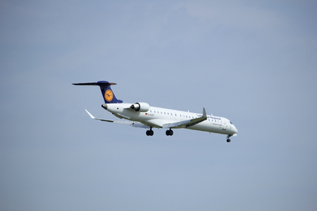 Amsterdam, the Netherlands - July 21st 2016:  D-ACKF Lufthansa CityLine Bombardier CRJ-900LR,  approaching Polderbaan runway at Schiphol Amsterdam Airport, arriving from Munich, Germany
