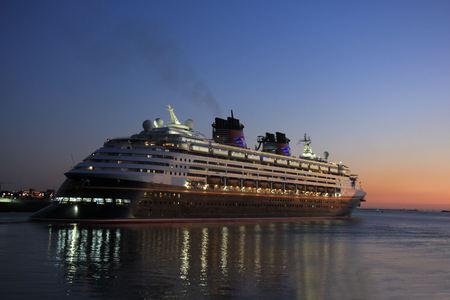 cruising: IJmuiden, the Netherlands - May, 25th 2017: Disney Magic leaving North Sea lock, IJmuiden.