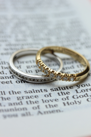 Two diamond wedding bands for a double bride wedding, on a bible verse Stock Photo