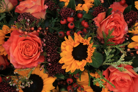 Big Yellow Sunflowers And Orange Roses In A Floral Wedding