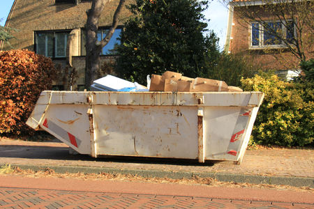 Loaded dumpster near a construction site, home renovation Stock fotó - 80032573