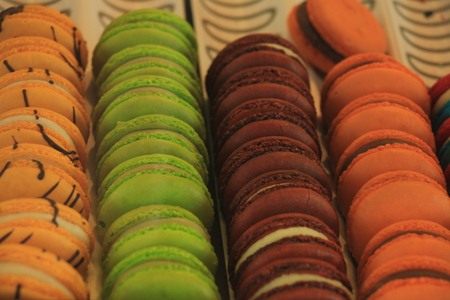 Macarons in various flavors and colors on display in a store